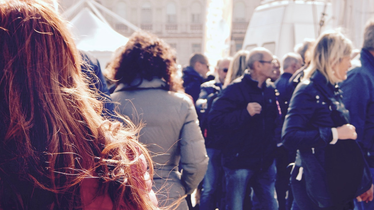 Red Haired Woman in a Crowd