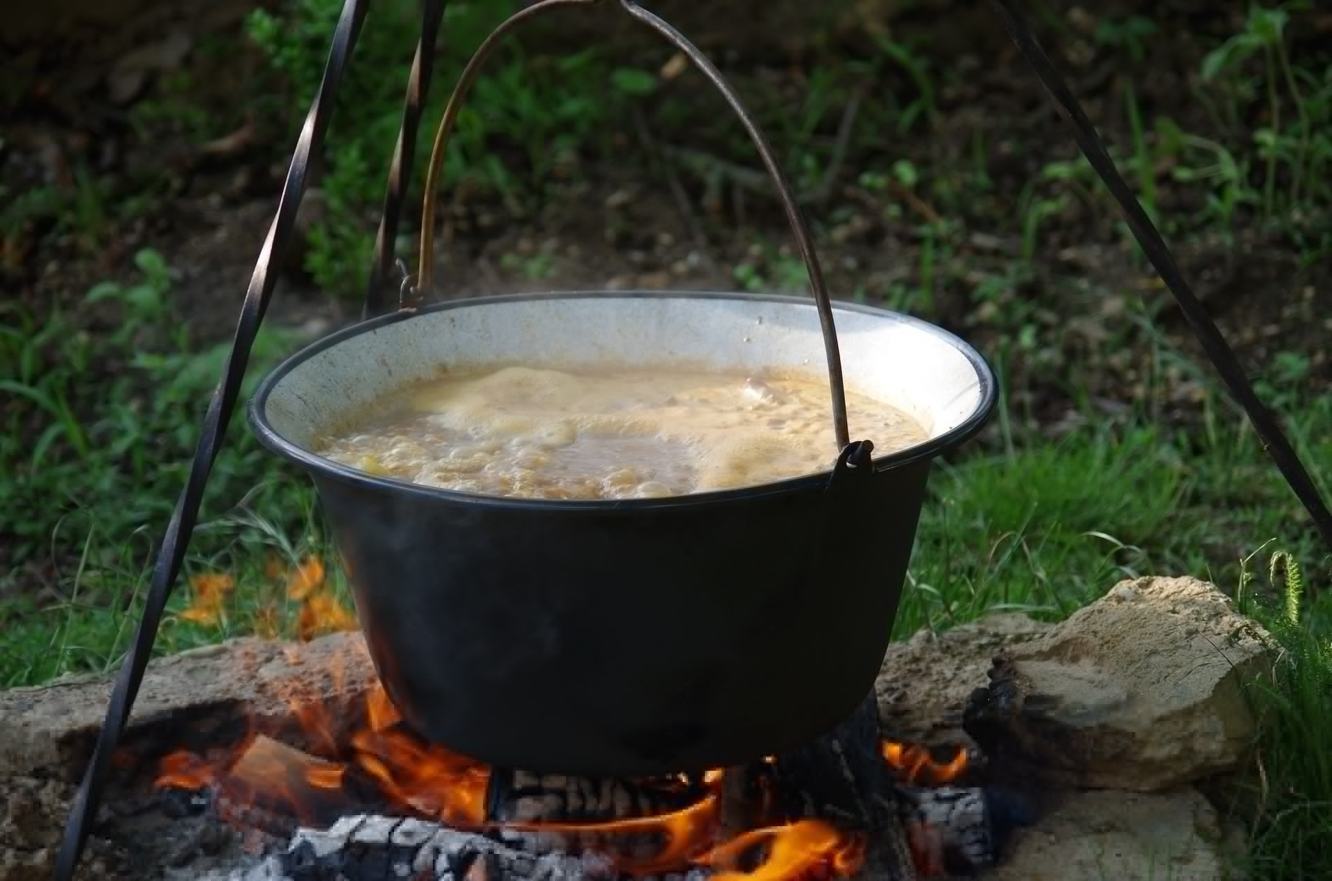 Irish Medieval Iron Age food - cooking pottage stew in a cauldron over a fire